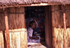 Bazaruto island: mulher numa cabana / lady in a traditional house (photo by Francisca Rigaud)