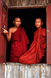 Myanmar - Kalaw - Shan State: two novice monks at a window - people - Asia - photo by W.Allgöwer