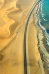 Namibia: Aerial view of Skeleton Coast with road - photo by B.Cain
