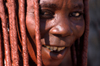 Namibia: Himba Woman face close-up, Skeleton Coast, Kunene region - photo by B.Cain