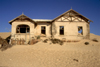 Namibia - Kolmanskop: ghost house claimed by the desert - photo by G.Friedman