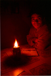 Nepal - Annapurna region: portrait by candlelight (photo by G.Friedman)