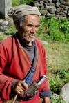 Nepal - Langtang region - old Tamang man carring a typical Nepali knife - photo by E.Petitalot
