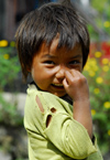 Nepal - Langtang region - poor child wipes his nose with fingers - photo by E.Petitalot