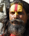 Kathmandu, Nepal: a follower of shiva has the symbol of the god painted on the forehead - photo by E.Petitalot