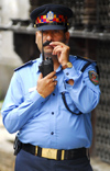 Kathmandu, Nepal: police chief with a walkie-talkie - photo by E.Petitalot