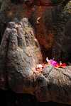 Kathmandu, Nepal: hands of stone statue with flower offerings - photo by J.Pemberton