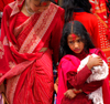 Kathmandu, Nepal: woman and daughter at Teej, the Hindu women's festival, celebrated for marital felicity, well-being of family and purgation of own body and soul - photo by J.Pemberton
