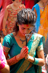 Kathmandu, Nepal: elegant young woman praying with incense - photo by J.Pemberton