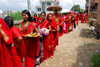 Kathmandu, Nepal: women with with offerings of flowers and fruits (prasadam) queue to enter Koteshwar temple, during women's festival - Teej - photo by J.Pemberton