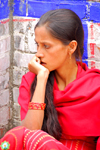 Kathmandu, Nepal: pensive young woman in red sari - photo by J.Pemberton