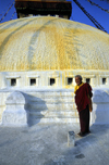 Kathmandu valley, Nepal: Bodhnath temple - monk at the central stupa - photo by W.Allg�wer