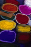 Kathmandu, Nepal: Asan Tole market - color powders for the lights and colors festival, Tihar - crows, dogs, cows, and Laxmi - the Goddess of Wealth are worshipped in this festival - photo by W.Allg�wer