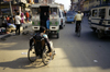 Kathmandu, Nepal: using a wheelchair on a busy street - photo by W.Allg�wer
