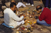 Kathmandu valley, Nepal: Swayambhunath temple - men performing puja - prasad - offers - photo by W.Allgöwer