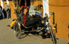 Kathmandu, Nepal: pedicab - a cycle rickshaw driver taking a nap - Durbar Square - photo by W.Allg�wer