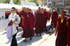 Kathmandu valley, Nepal: woman and monks at Bodhnath / Boudhanath temple complex - known to Newars as Khasti Chitya - photo by W.Allg�wer