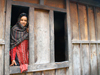 Annapurna region, Nepal: young woman at a window - photo by M.Wright