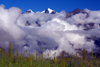 Annapurna region, Nepal: peaks, clouds and grass - view form Jharkot, Mustang district - photo by M.Wright