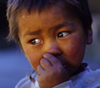 Annapurna area, Nepal: close-up of a boy's face - photo by W.Allgöwer
