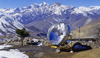 Annapurna area, Nepal: solar thermal collector - parabolic dish and mountains - photo by W.Allgöwer