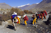 Upper Mustang district, Annapurna area, Dhawalagiri Zone, Nepal: sherpas cross a stream - photo by W.Allg�wer