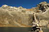 Khumbu region, Solukhumbu district, Sagarmatha zone, Nepal: a cairn in a front of an altitude lake - photo by E.Petitalot