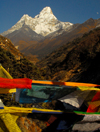 Khumbu region, Solukhumbu district, Sagarmatha zone, Nepal: prayer flags and Ama Dablam mountain, 6,812 m - the 'Mother and Pearl Necklace' - photo by E.Petitalot