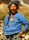 Namche Bazaar, Khumbu region, Solukhumbu district, Sagarmatha zone, Nepal: typical tibetan guy at the market - photo by E.Petitalot