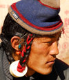 Khumbu region, Solukhumbu district, Sagarmatha zone, Nepal: typical Tibetan hairstyle - photo by E.Petitalot