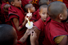 Kathmandu, Nepal: Tibetan monks - novices in a candle walk - boy monks - Buddhism - religion - photo by G.Koelman