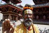 Kathmandu, Nepal: Sadhu with floral crown - Durbar Square - Hindu holy man - photo by G.Koelman