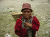 Tipylang, Myagdi District, Dhawalagiri Zone, Nepal: man with bamboo basket - dhoko - Annapurna Circuit - photo by M.Samper