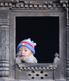 Nepal - Langtang region - baby looking outside - photo by E.Petitalot