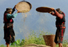 Nepal - Langtang region - two women use wind to separate grain and dust - photo by E.Petitalot