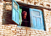 Nepal - Kathmandu valley: face in window (photo by G.Friedman)