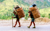 Nepal -  Annapurna region - Anapurna: sherpas with baskets (photo by G.Friedman)