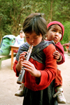 Nepal - Annapurna region: girl playing xaphoon (photo by G.Friedman)