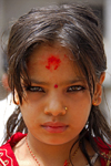 Kathmandu, Nepal: pretty girl with striking eyes and large tilaka - photo by J.Pemberton