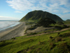 North Island - Coromandel Peninsula, Waikato region: beach and hill - photo by M.Samper