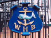96 New Zealand - North Island - Wellington - WHB - Wellington Harbour Board symbol on a gate - photo by Miguel Torres
