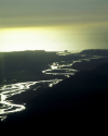 New Zealand - South island: Hokitika river - golden meanders, backlighted - from the air- photo by Air West Coast