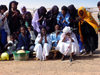 Agadez, Tchirozerine arrondissement, Niger: A�r Tuaregs sing the airport - photo by A.Obem