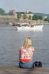 Norway / Norge - Oslo: girl looking at the Akershus fortress (photo by Juraj Kaman)