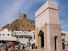 Oman - Muscat: arch and watch tower - photo by B.Cloutier