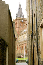 Orkney island, Mainland- Kirkwall - View of the cathedral, Saint Magnus from an alley - photo by Carlton McEachern