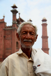 Lahore, Punjab, Pakistan: man in front of mosque - photo by G.Koelman