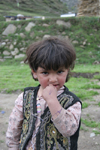 Jabbar, Siran Valley, North-West Frontier Province, Pakistan: little girl with fingers in her mouth - photo by R.Zafar