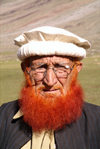 Pakistan - Shandur Pass - Chitral District, North-West Frontier Province: Pakistani man with hat and red beard - Pashtun - photo by R.Zafar