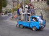 Karimabad / Baltit - Northern Areas, Pakistan: riding is better than walking - crowded Chinese made pick-up truck - Hunza Valley - KKH - photo by D.Steppuhn